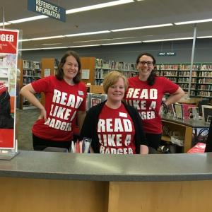 Pinney Librarians show off their summer reading spirit at the reference desk