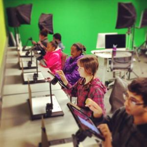 youth working on stop motion stations in the media lab
