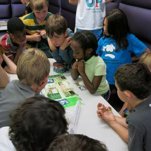 youth playing Pokemon Trading Card game