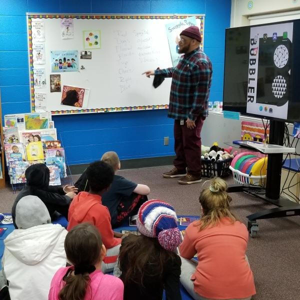 Rob Franklin instructs 4th grade students