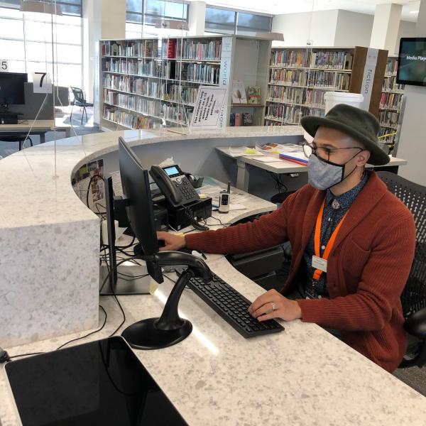 librarian Dominic Davis at the Pinney Reference Desk