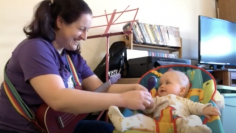 Woman and baby play music