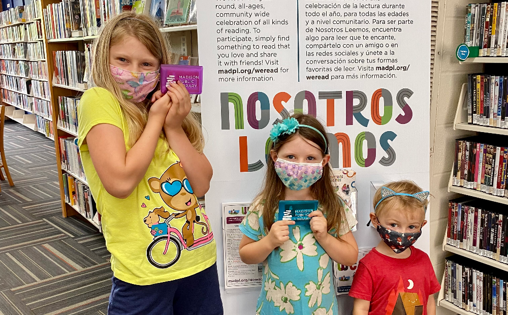 Kids receive their first library cards at Monroe Street Library. Library Card Sign-Up Month