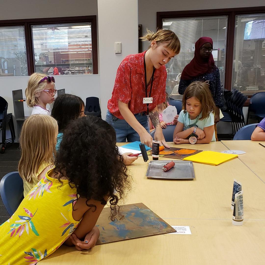 Kids gather around to learn foam block printing