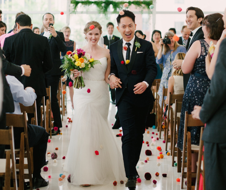 Bride and groom walk down the aisle after getting married at Central Library
