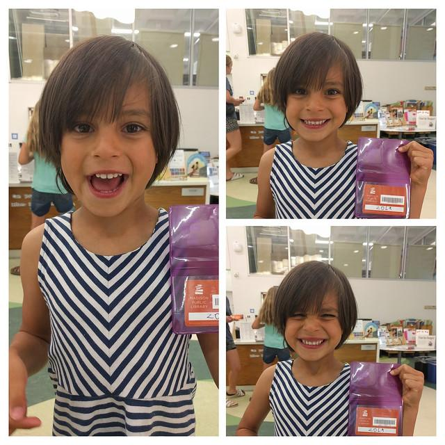 young girl with her first library card