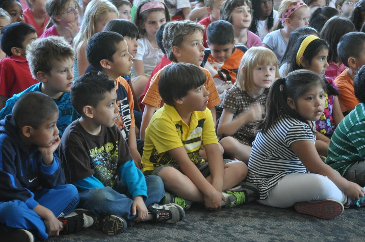 Midvale Elementary School students viewing a special performance from the cast of Disney's The Lion King