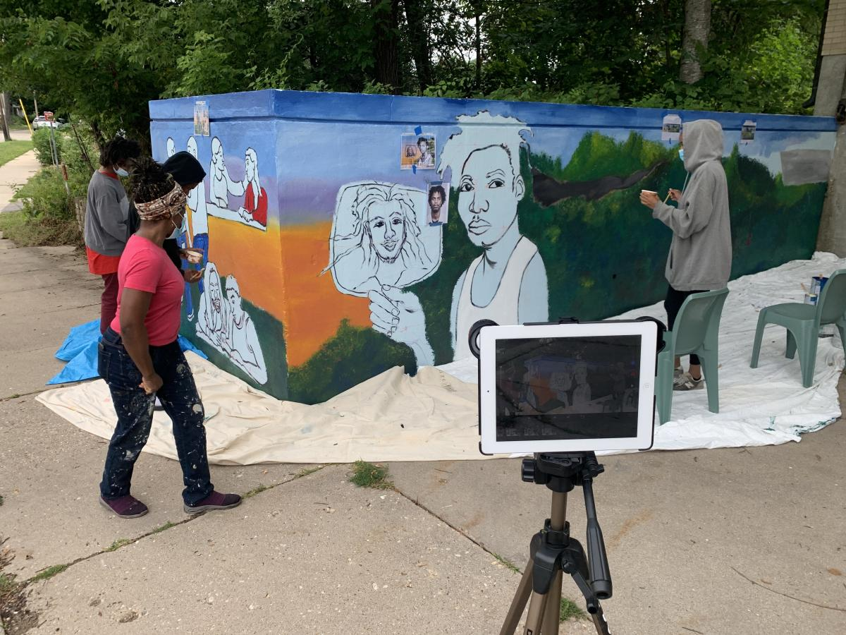 Teens at work on the mural