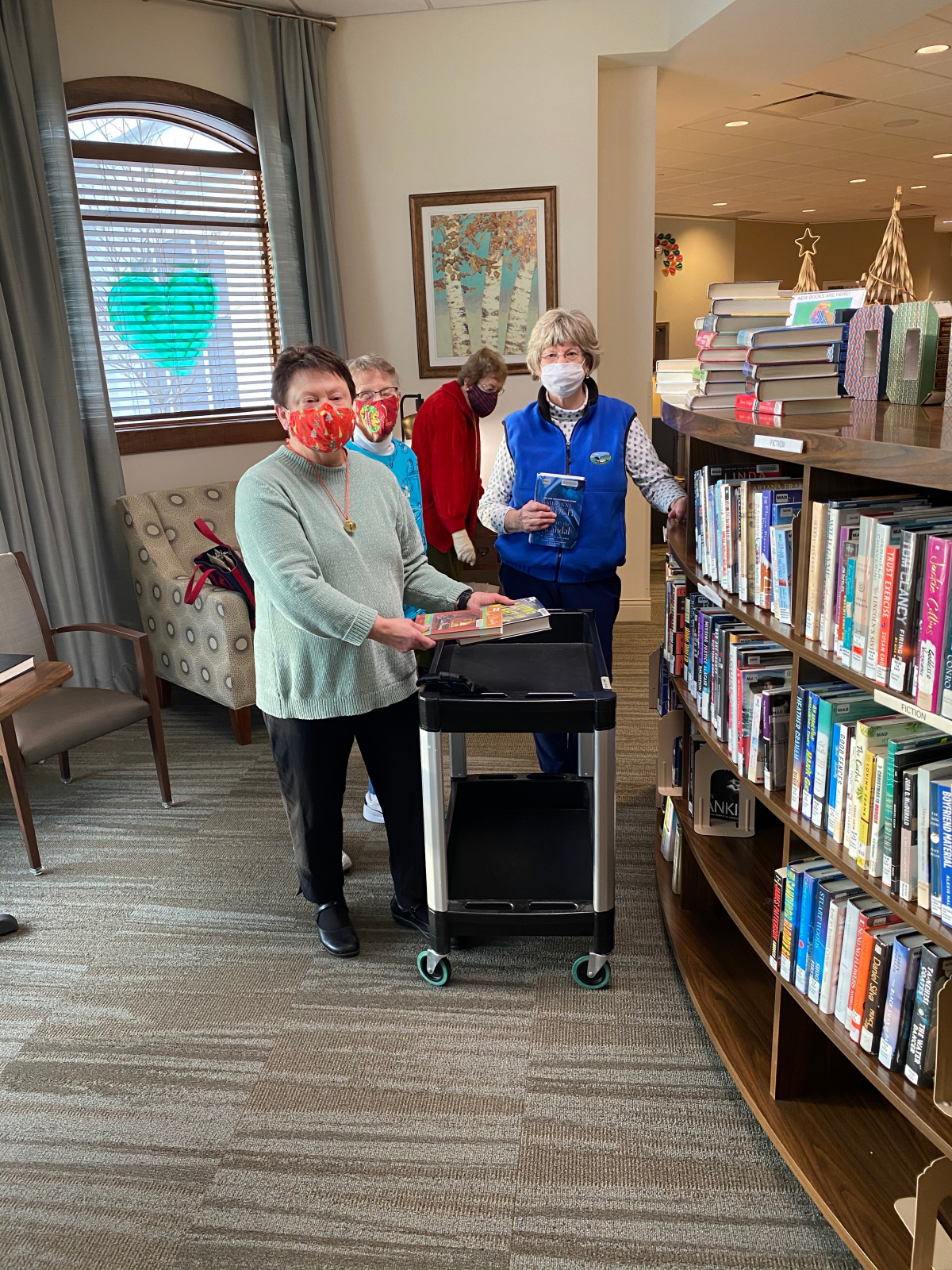 Oak Village Prairie Ridge resident volunteers stock their book nook