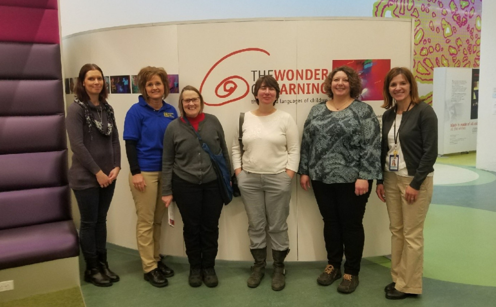 Group of educators in the Wonder of Learning exhibit