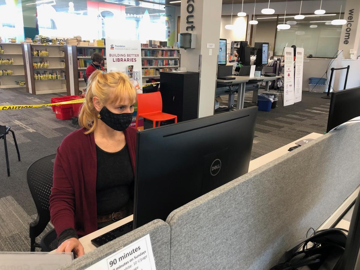Librarian Crista Parimentner resets a computer for the next patron