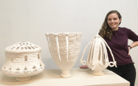 Artist Juliette Walker with her ceramic lamp creations