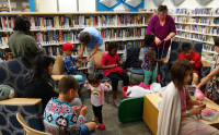 Group of kids and adults knitting at the library